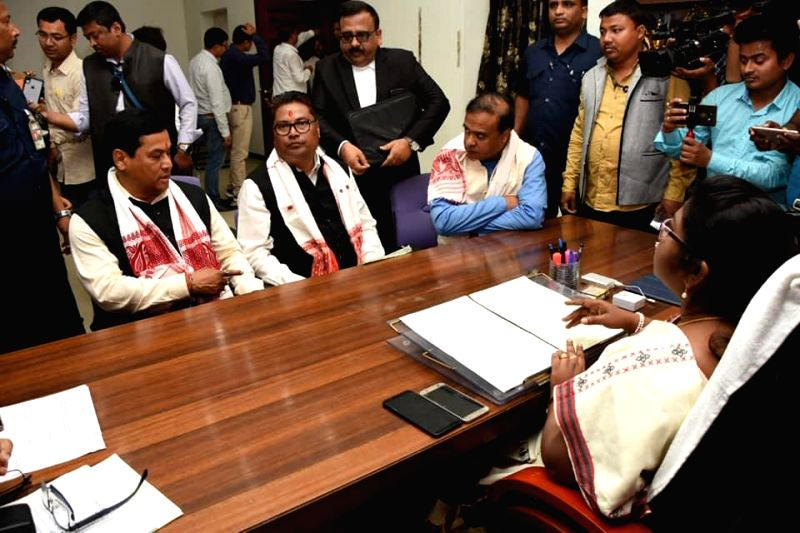 Jorhat: BJP candidate Topan Kumar Gogoi files his nomination papers for upcoming Lok Sabha polls in Jorhat on March 26, 2019. Also seen party leaders Himanta Biswa Sarma and Sarbananda Sonowal. (Photo: IANS)