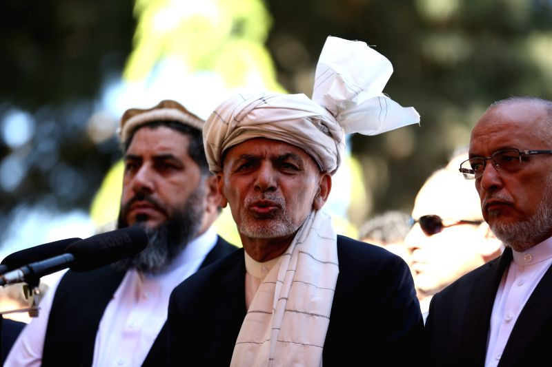 KABUL, June 4, 2019 (Xinhua) -- Afghan President Mohammad Ashraf Ghani (C) speaks during the Eid al-Fitr prayer at the presidential palace in Kabul, capital of Afghanistan, June 4, 2019. Afghan President Mohammad Ashraf Ghani on Tuesday expressed his