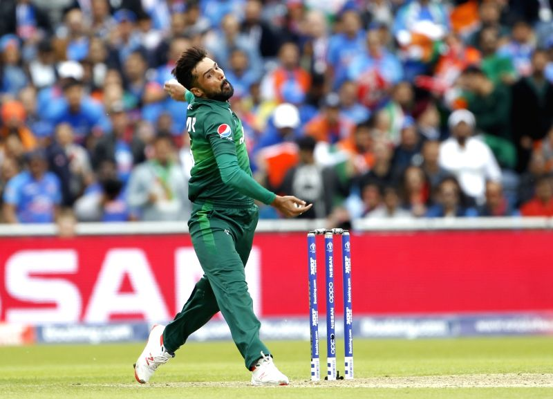 Manchester: Pakistan's Mohammad Amir in action during the 22nd match of 2019 World Cup between India and Pakistan at Old Trafford in Manchester, England on June 16, 2019. (Photo: Surjeet Yadav/IANS)
