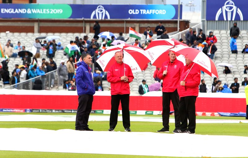 Manchester: Umpires inspect the field at the Old Trafford after rains delayed the 22nd match of 2019 World Cup between India and Pakistan in Manchester, England on June 16, 2019. (Photo: Surjeet Yadav/IANS)