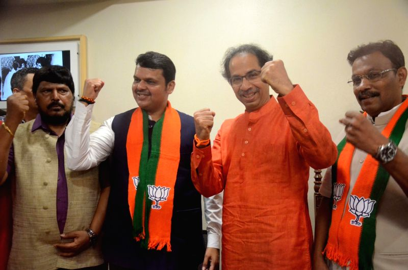 Mumbai: Maharashtra Chief Minister Devendra Fadnavis, Union Minister Ramdas Athawale and Maharashtra Cabinet Minister Vinod Tawde and Shiv Sena chief Uddhav Thackeray celebrate as the BJP-led NDA is set to retain power for another five years after ma
