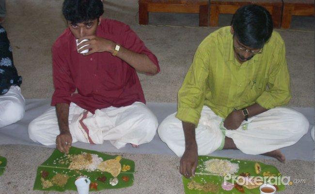 People enjoying Onasadhya