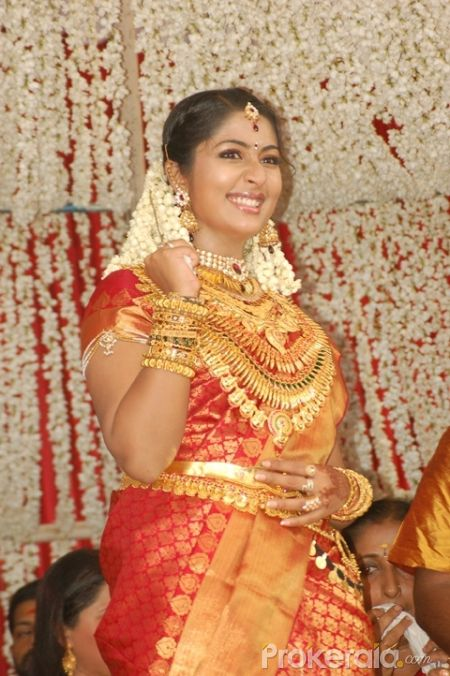 Actress Navya Nair Santhosh Menon Wedding Stills