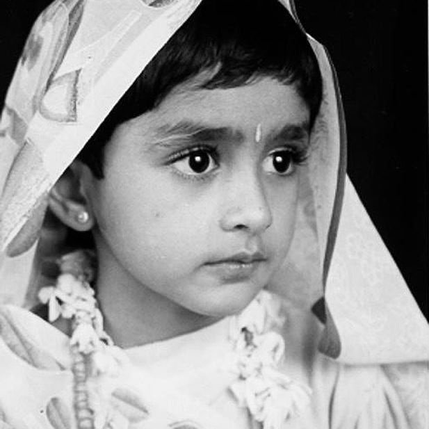 Guess the celebrity from her childhood photo