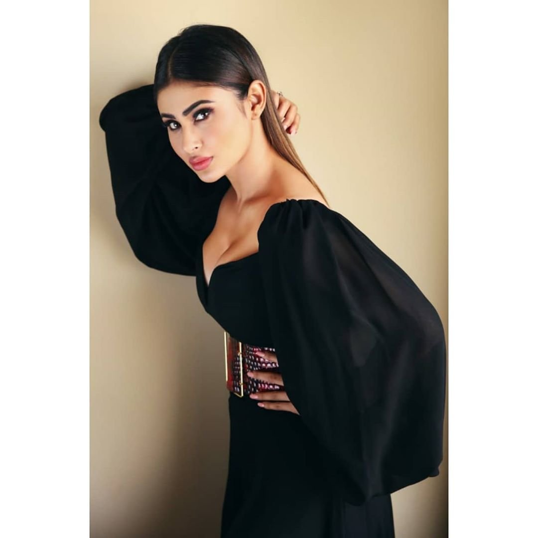 Mouni Roy in a black deep plunging gown