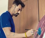 Arjun Rampal paints on canvas as he documents his quarantine life; fan asks who clicked his photo