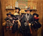 Madhuri Dixit poses with husband Shriram Nene and sons Arin and Ryan in a Western-themed throwback pic