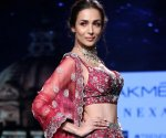 Malaika Arora is a captivating bride in the colour of love, as she walks for Varun Chakkilam at Lakme Fashion Week