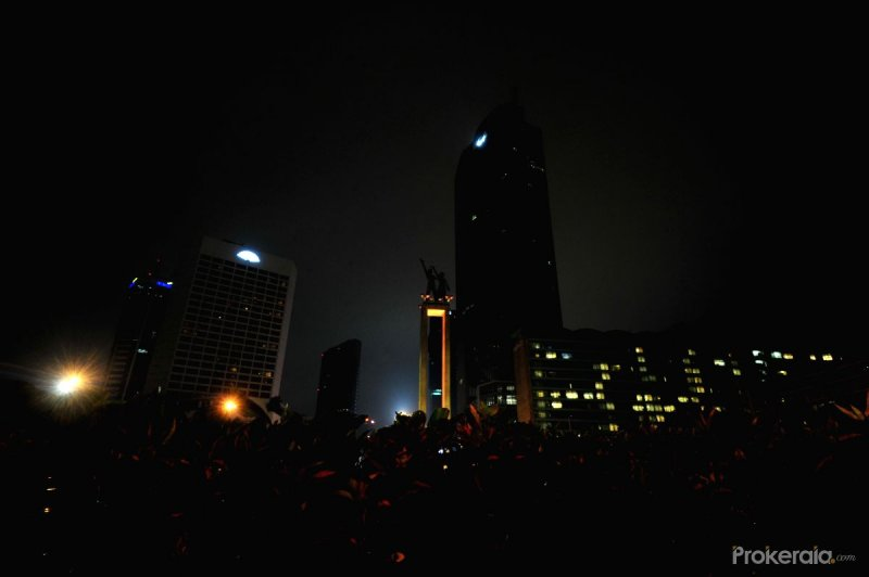 City view as lights go out during the Earth Hour campaign in Jakarta, Indonesia.