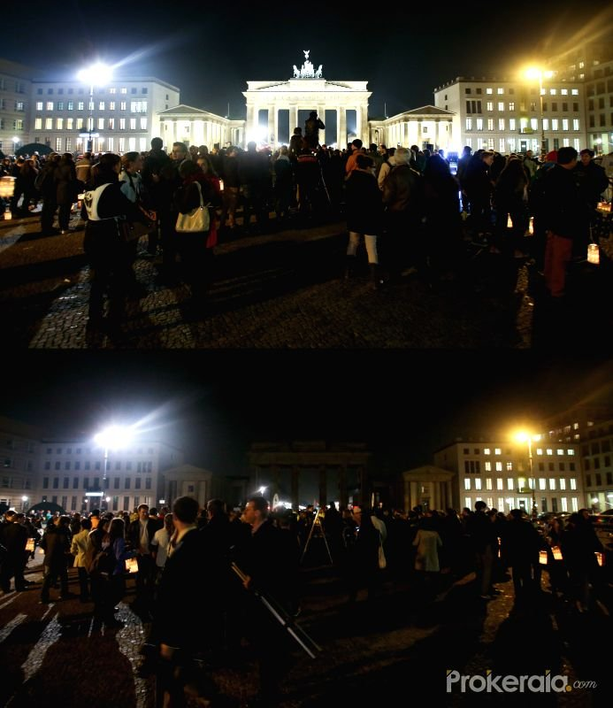 The combo picture taken on March 29, 2014 shows the lighted (up) and unlighted (down) Brandenburg Gate during the Earth Hour 2014 campaign in Berin, Germany