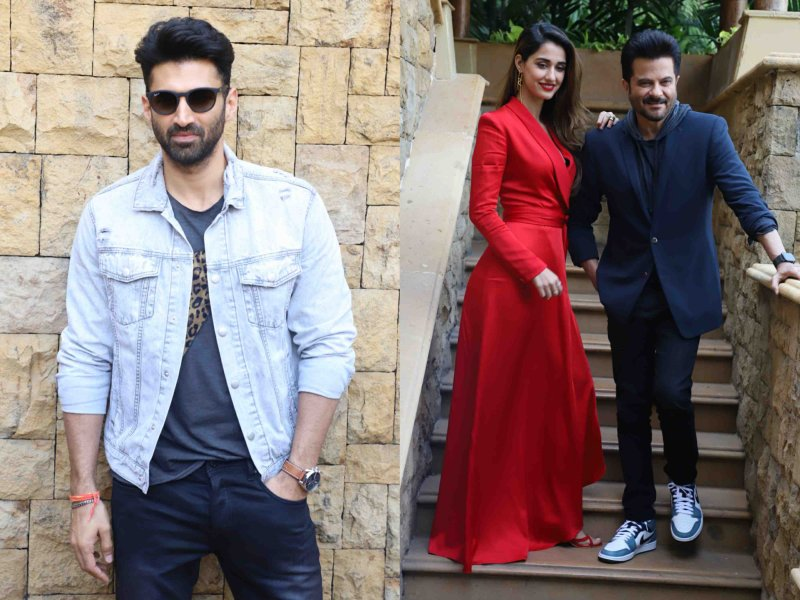 Disha poses with Anil Kapoor, Aditya in casuals