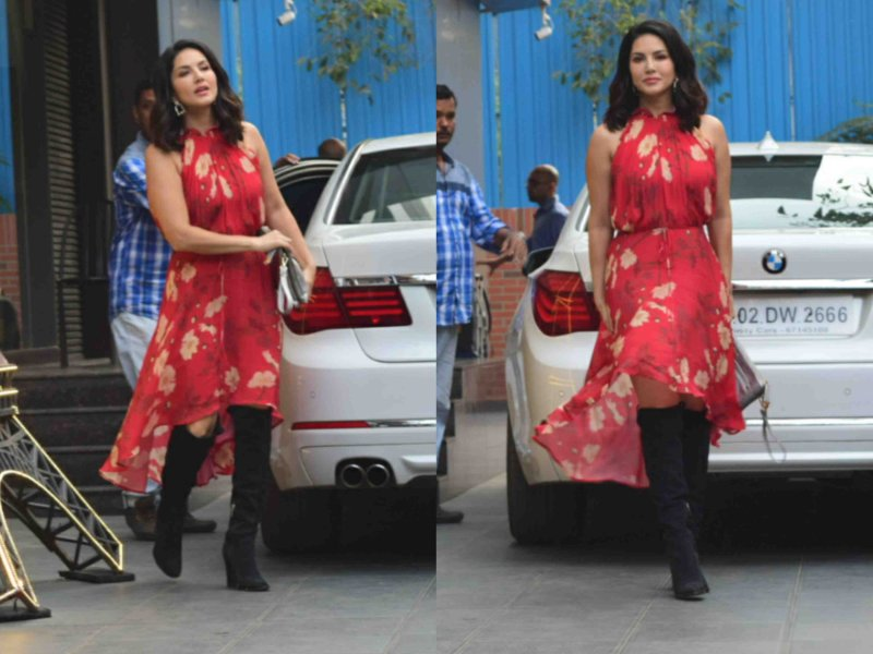 Sunny Leone pairs black boots with cold shoulder red dress