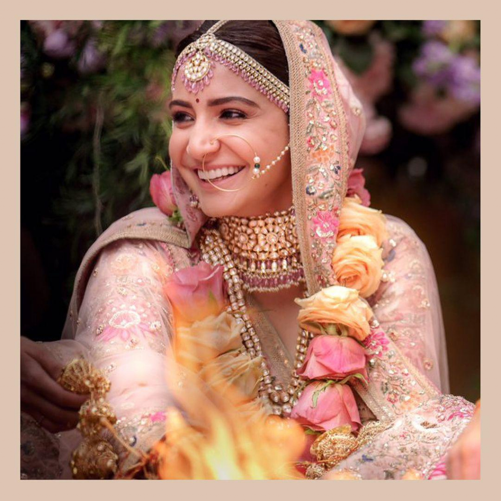 Anushka looks as pretty as a rose on her wedding day