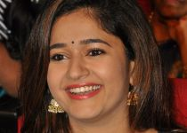 Poonam Bajwa @ Thikka Telugu movie Audio Launch Function Stills