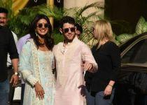Priyankaand Nick posing for media after finishing their wedding puja