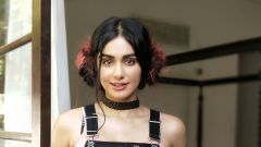 Gorgeous Adah with a quirky hairdo behind the scenes of an ad campaign