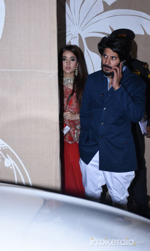 Actor Dulquer Salmaan with his wife at actor Amitabh Bachchan's Diwali party