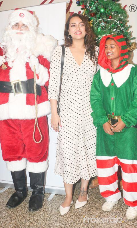 Actress Sonakshi Sinha celebrates Christmas with children.