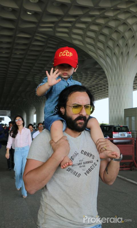 Saif & Taimur spotted at airport - photos
