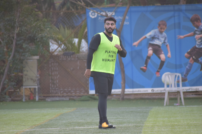 Actor Arjun Kapoor  playing football at juhu