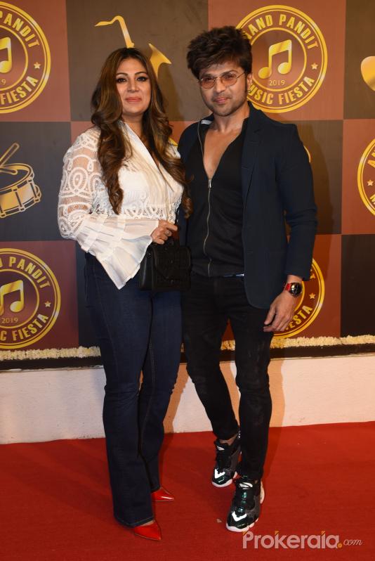 Actor Himesh Reshammiya and Wife at Anand Pandit's birthday party.