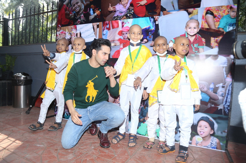 Actor Varun Dhawan join children fighting cancer in a celebration.