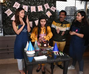 Actress  Alia Bhatt Baking a Cake With Her Fan For Anshula's Fundraising And Charity Foundation