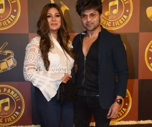 Actor Himesh Reshammiya and Wife at Anand Pandit's birthday party.