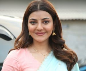 Actress Kajal Aggarwal poses for photo during her film location