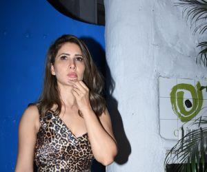 Actress Kim Sharma in birthday party at olive bandra.