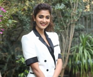Actress Pooja Hegde Posses for Photo.