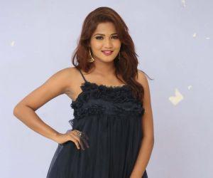 Actress Sravani Nikki In a Black Dress.