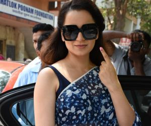 Actress Kangana Ranaut voting at Khar