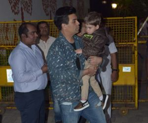 Karan Johar With his son at Aaradhya Bachchan birthday party