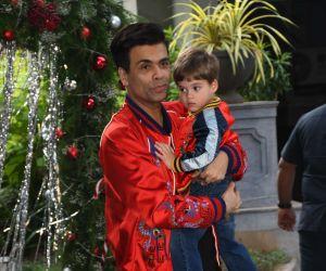 Karan Johar With his son at  Taimur Ali Khan Party.