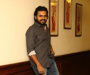 Actor Karthi Posses for Photo.