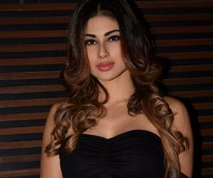 Made in China girl Mouni Roy looks chic yet hot in a tiny blue skirt
