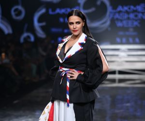 Actress Neha Dhupia walk the ramp at Lakme Fashion Week in mumbai