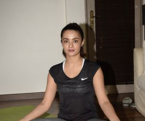 Surveen Chawla doing yoga on the eve of World Yoga Day