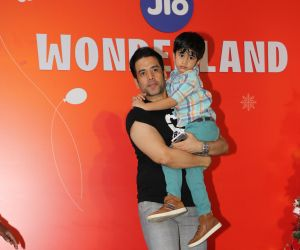 Actor Tusshar Kapoor with his kid at The Premier Night Of Jio Wonderland.