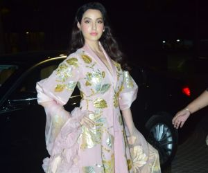 Nora Fatehi walking on red carpet For Lodha Luxury