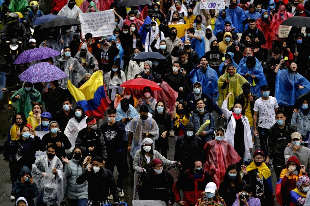 05 May 2021, Colombia, Bogota: Protesters take part in a demonstration against President Duque's government and police violence following the death of at least 19 people during last week rallies. ...
