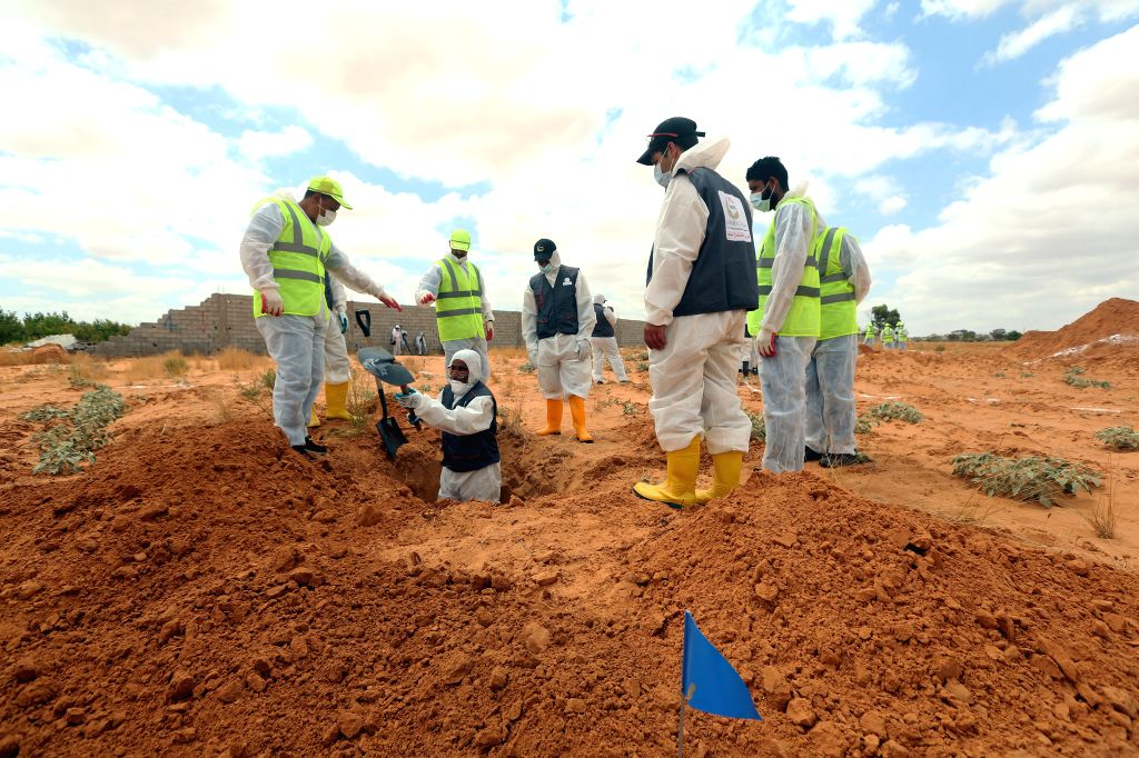 12 bodies recovered in Libya mass graves