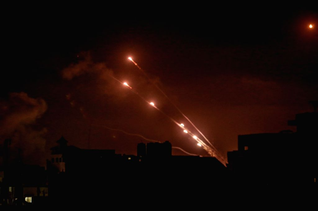12 May 2021, Palestinian Territories, Gaza City: Rockets are fired by the Palestinian Islamist movement Hamas from Gaza City towards Israel, amid the escalating flare-up of Israeli-Palestinian ...