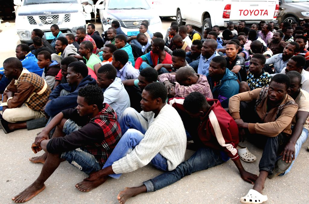 130 illegal immigrants who were intercepted by Libyan coast guards off Tripoli coast are seen in Libya on Oct. 21, 2015.