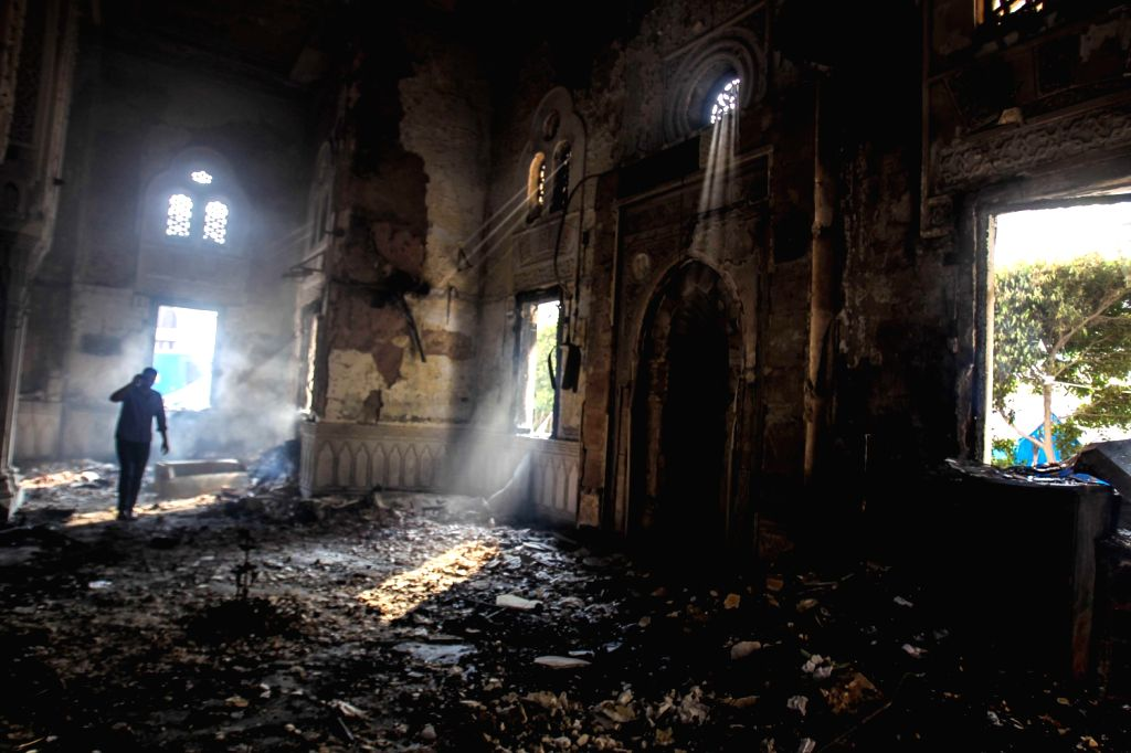 A man walks in the Raba'a Al-Adaweya Mosque after the dispersal of sit-in in Raba'a Al-Adaweya square in Cairo's Nasr City, Egypt, Aug. 15,