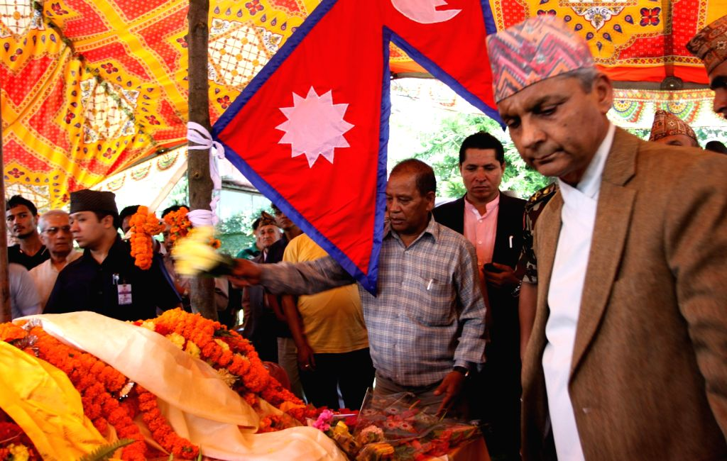 Chairman of Interim Election Council, Khil Raj Regmi (1st R), pays respects to former Nepalese Prime Minister Marich Man Singh Shrestha during his ...