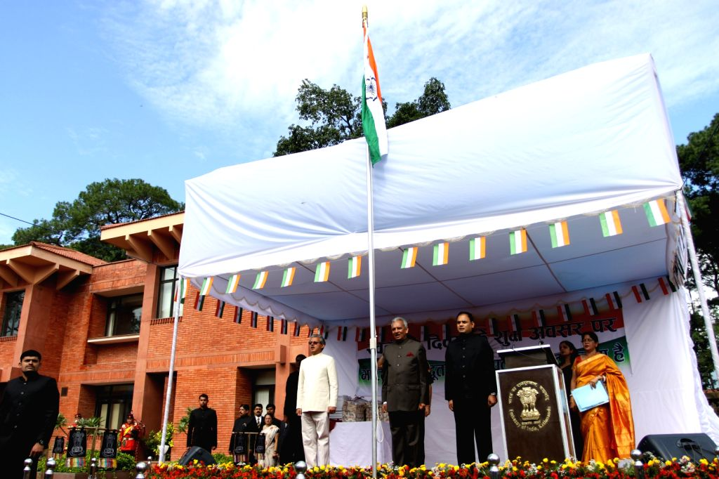 Indian Ambassador  to Nepal Jayant Prasad (C) attends the national flag raising ceremony to mark India's 67th Independence day at the Embassy of .