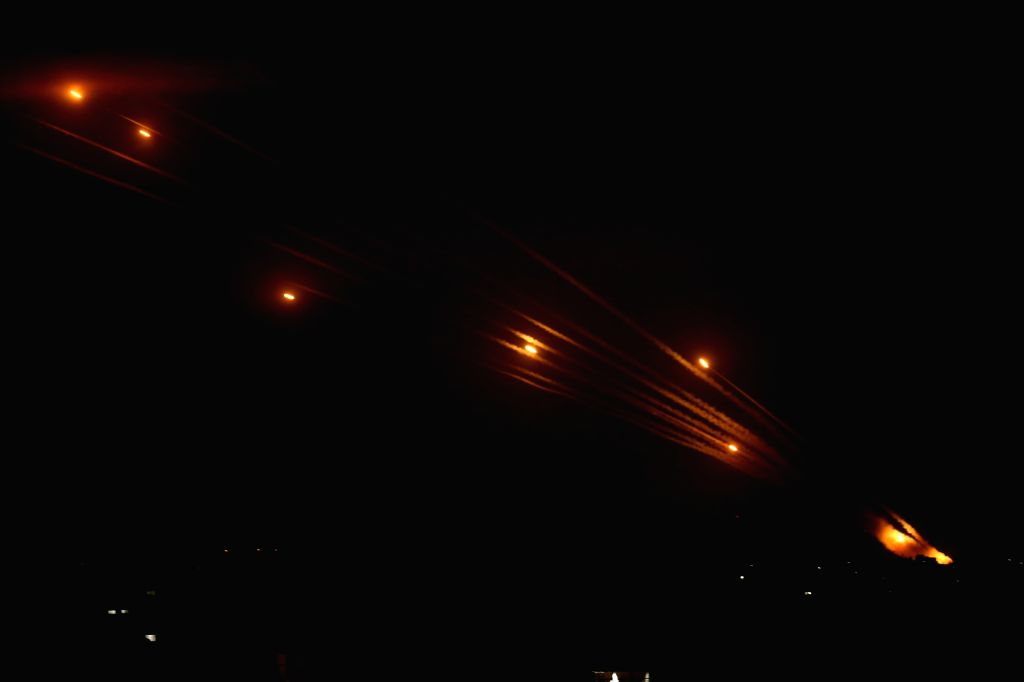 14 May 2021, Palestinian Territories, Beit Lahia: Rockets are fired by the Palestinian Islamist movement Hamas from Beit Lahia in the northern Gaza Strip towards Israel, amid the escalating flare-up ...
