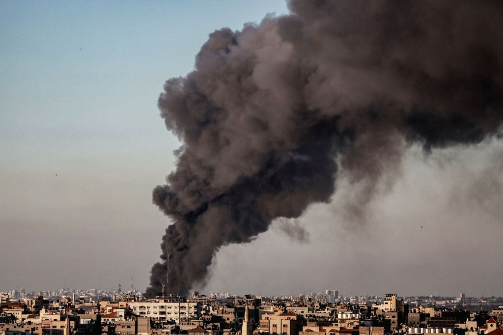 14 May 2021, Palestinian Territories, Gaza City: Thick smoke rises above buildings in Gaza City, following several Israeli airstrikes, amid the escalating flare-up of Israeli-Palestinian violence. ...